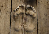 Footprints-carved-in-wood-0